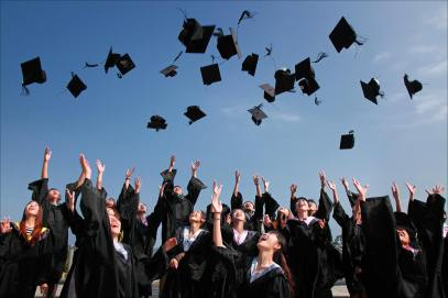 College grads throwing caps in the air